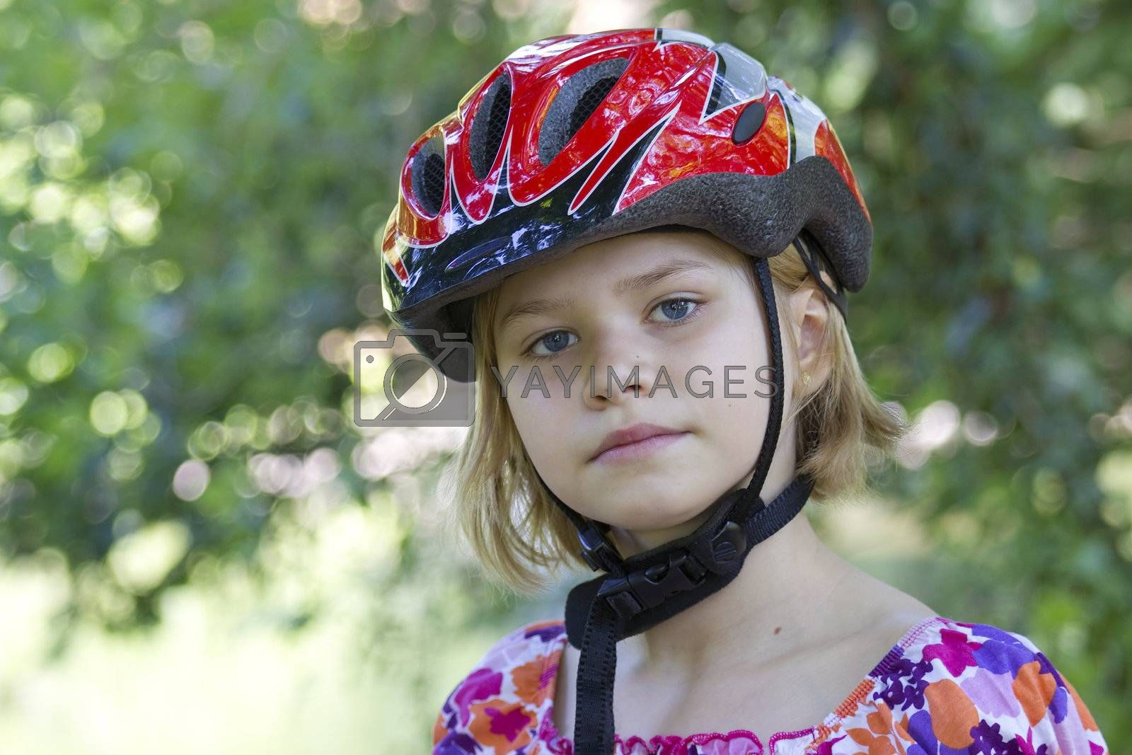 girl wearing a bike helmet