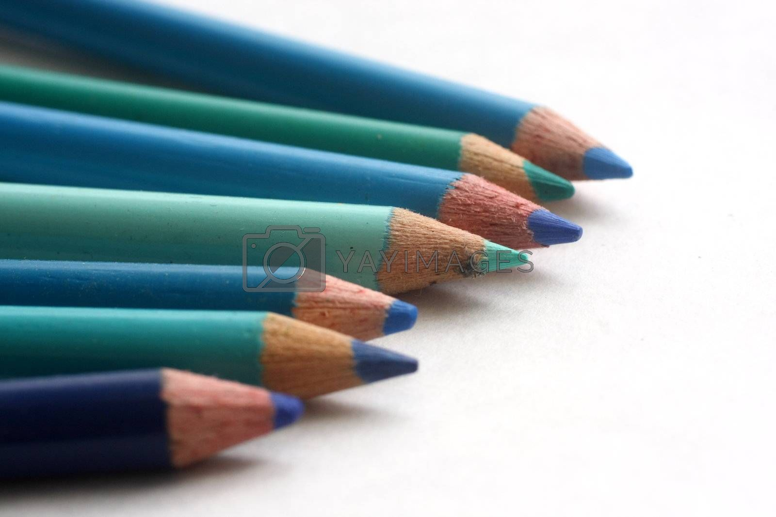 Coloring pencils of blue hues on white background
