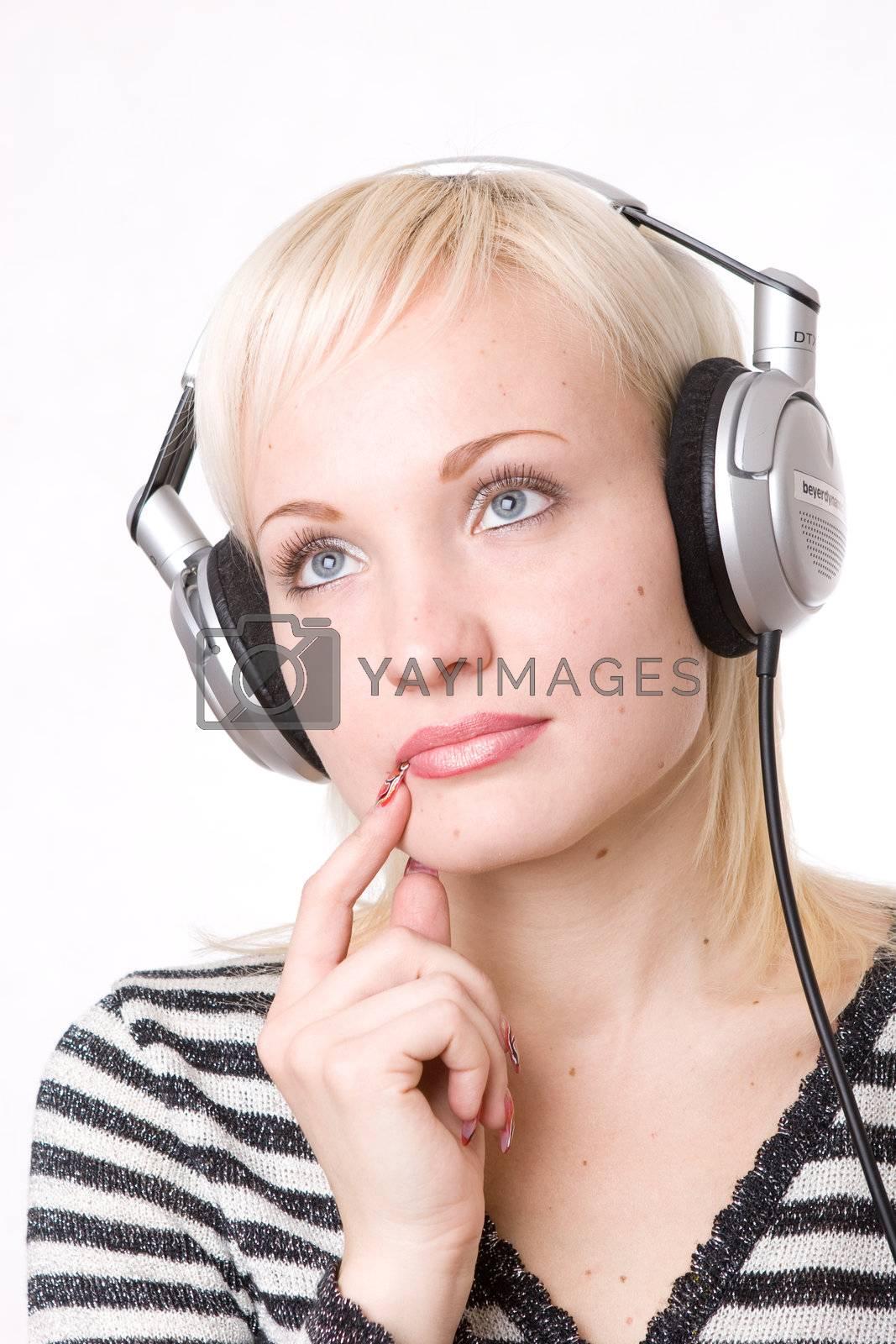 a pensive girl in headphones listening music