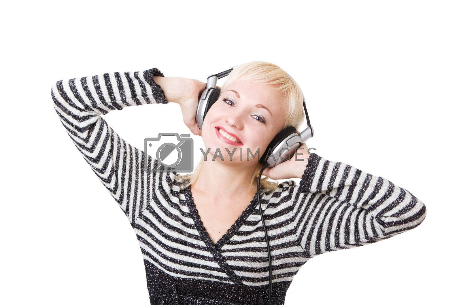 a happy girl in headphones listening music