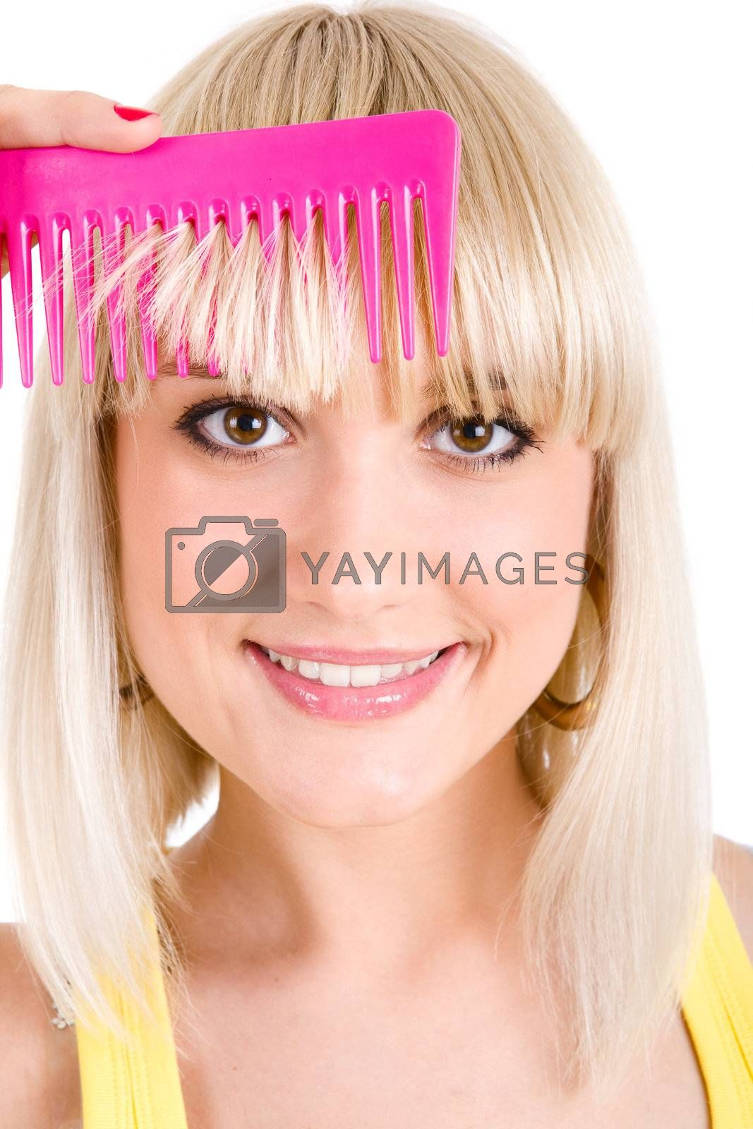 blonde girl combs her hair