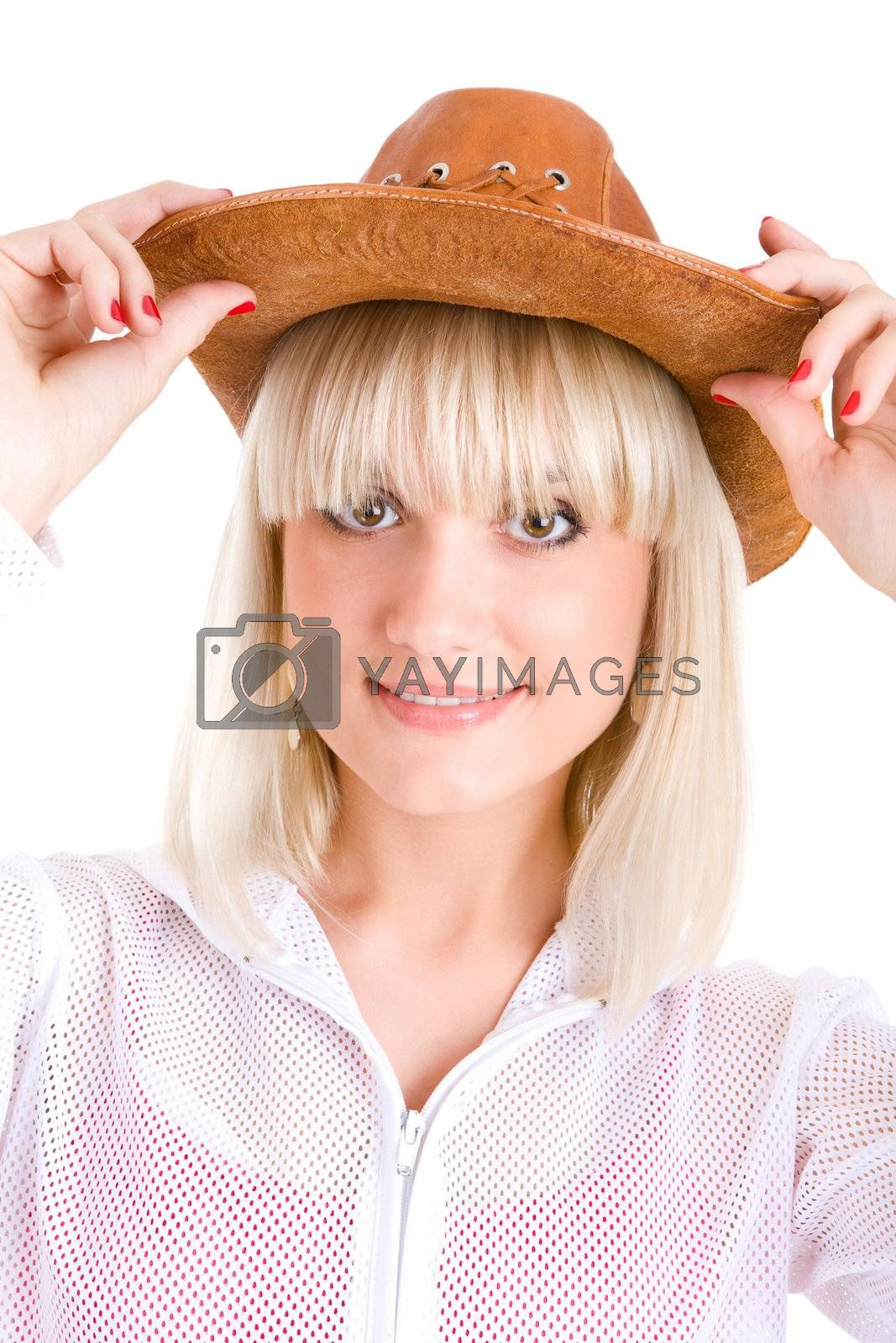 blond girl puts on a cowboy hat
