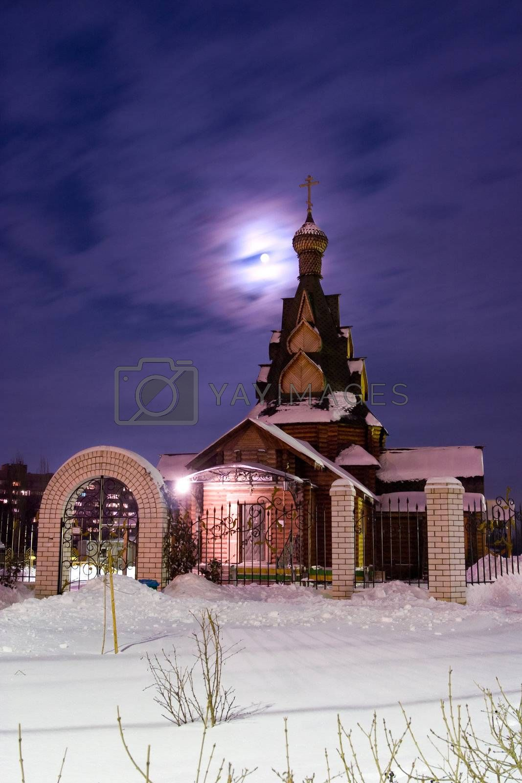 Church in a snow at a moonlight