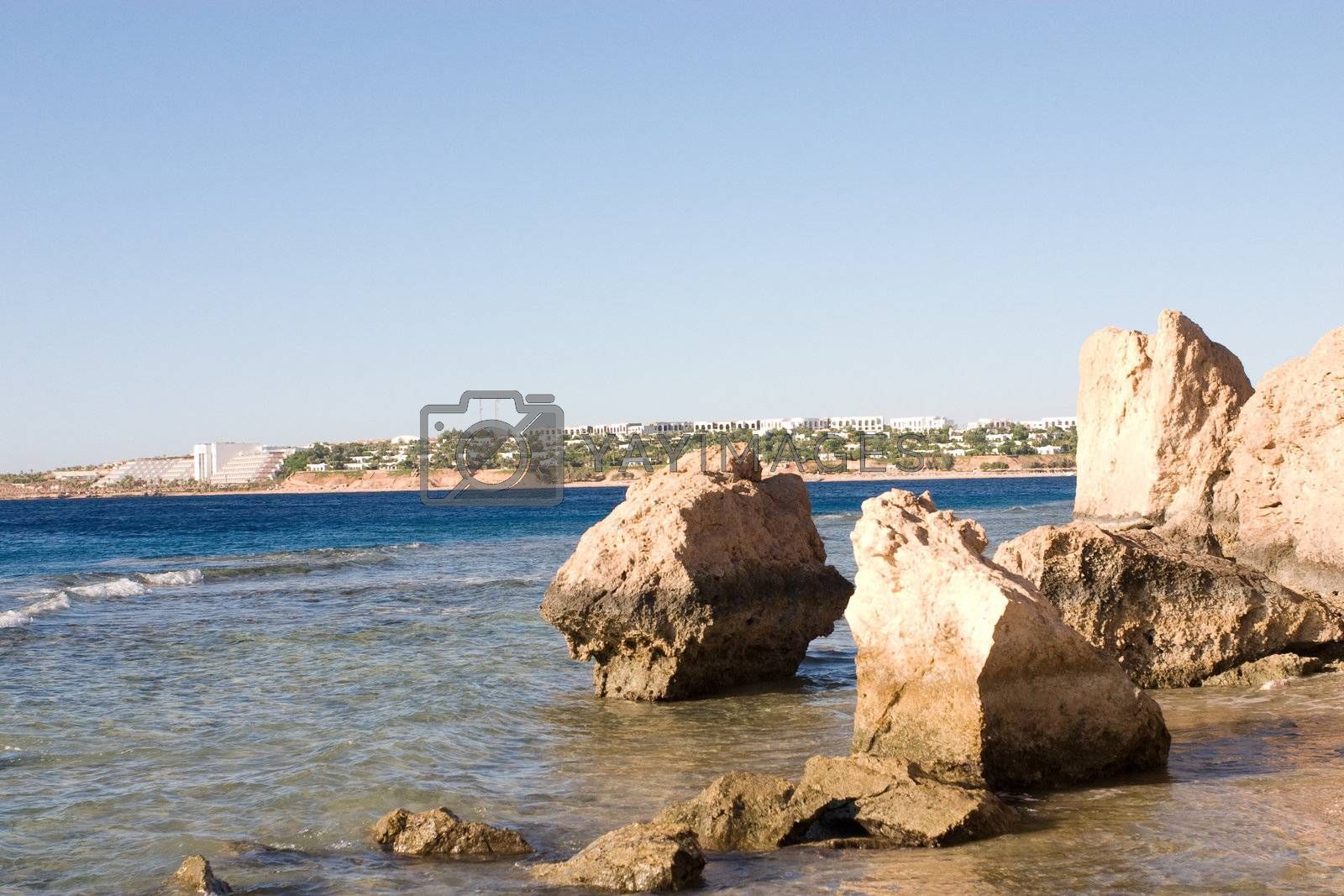 a view to the hotel line of the Red Sea through the rocks and sea