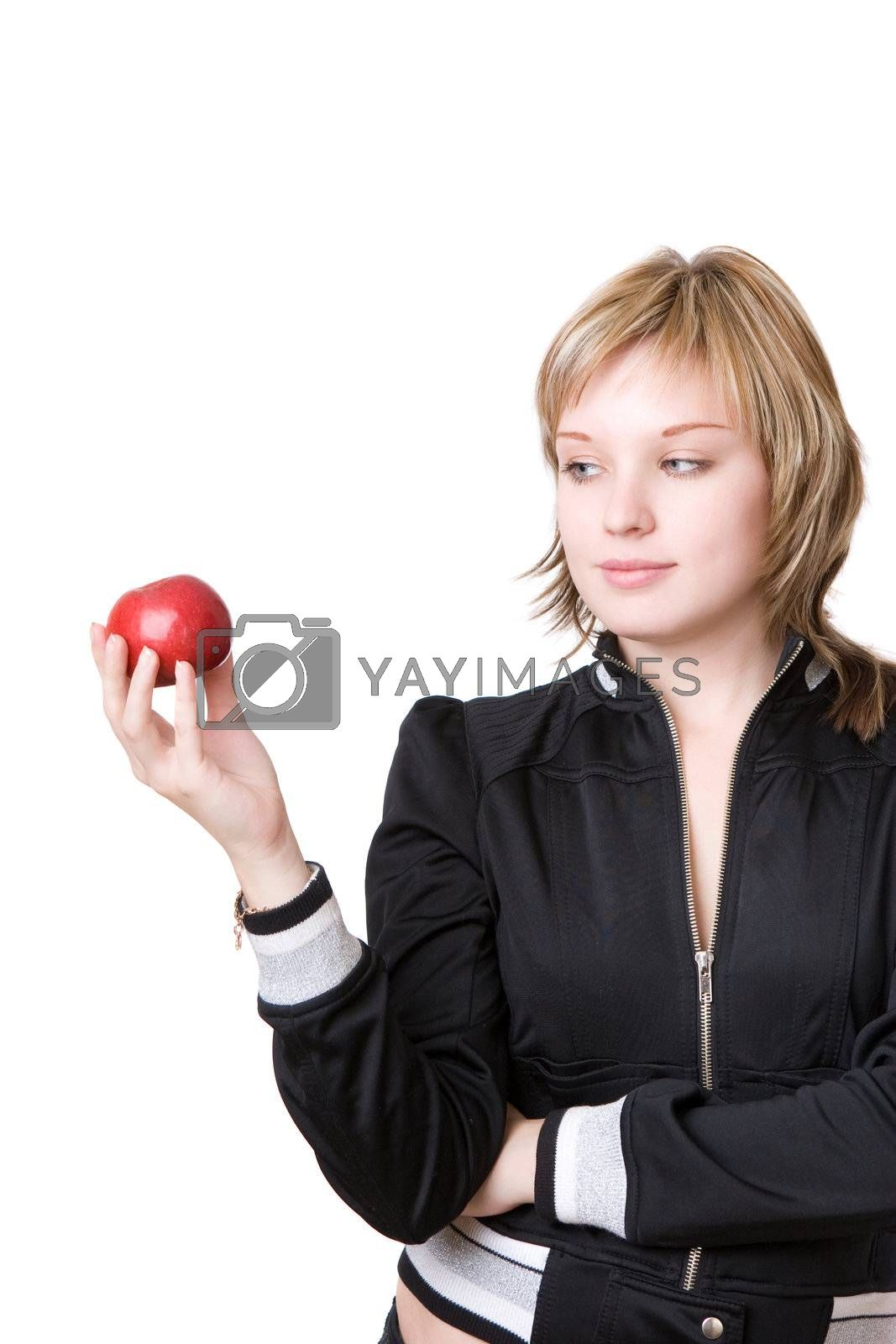 girl holds an apple in a hand