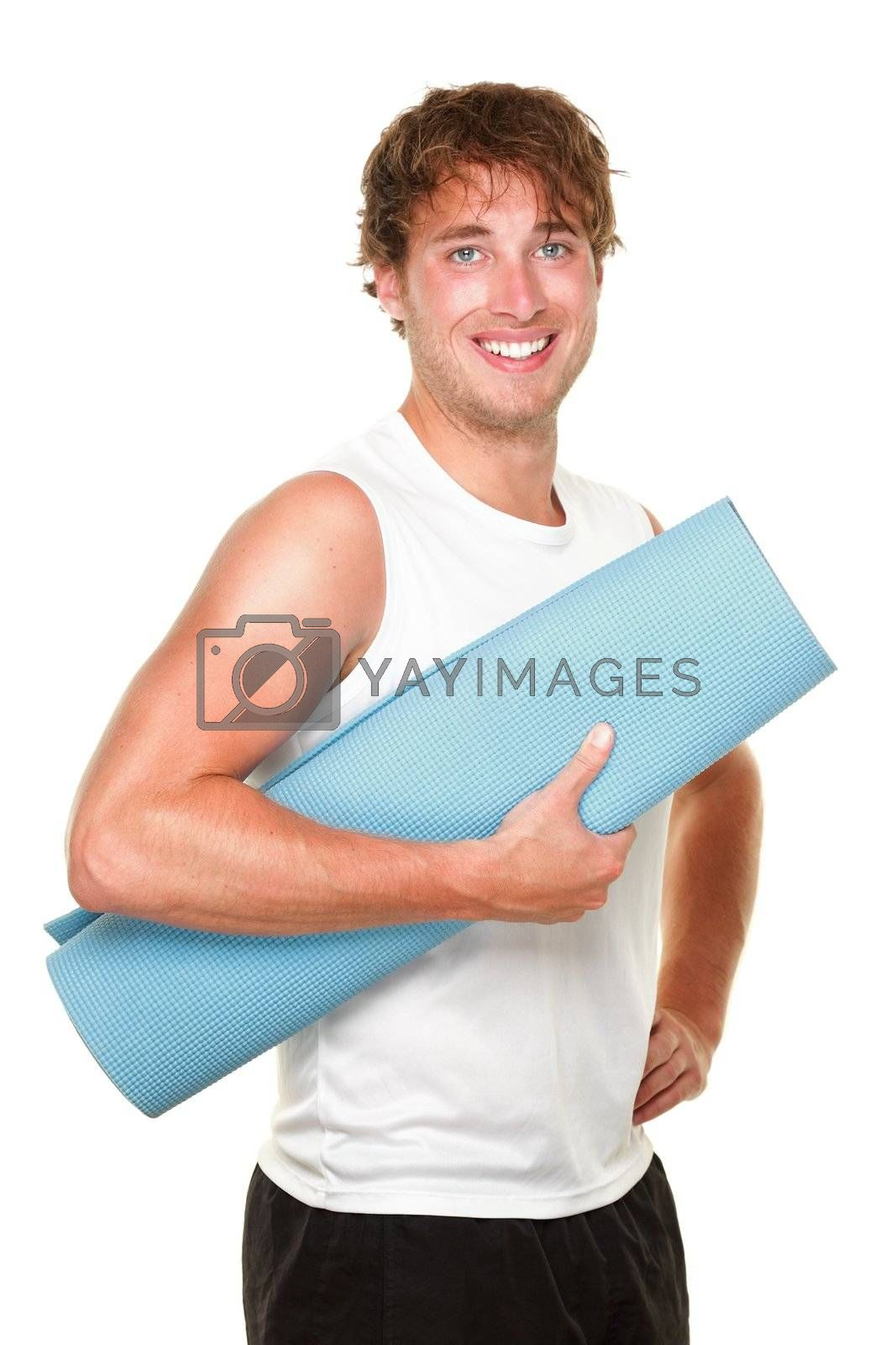 Fitness man holding yoga training mat. Young muscular sporty man isolated on white background.