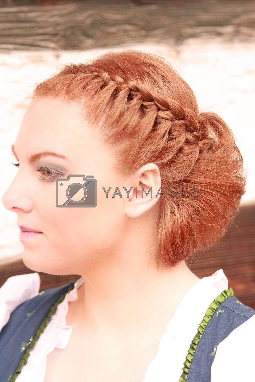 Red-haired woman with traditional hairstyle Bavarian