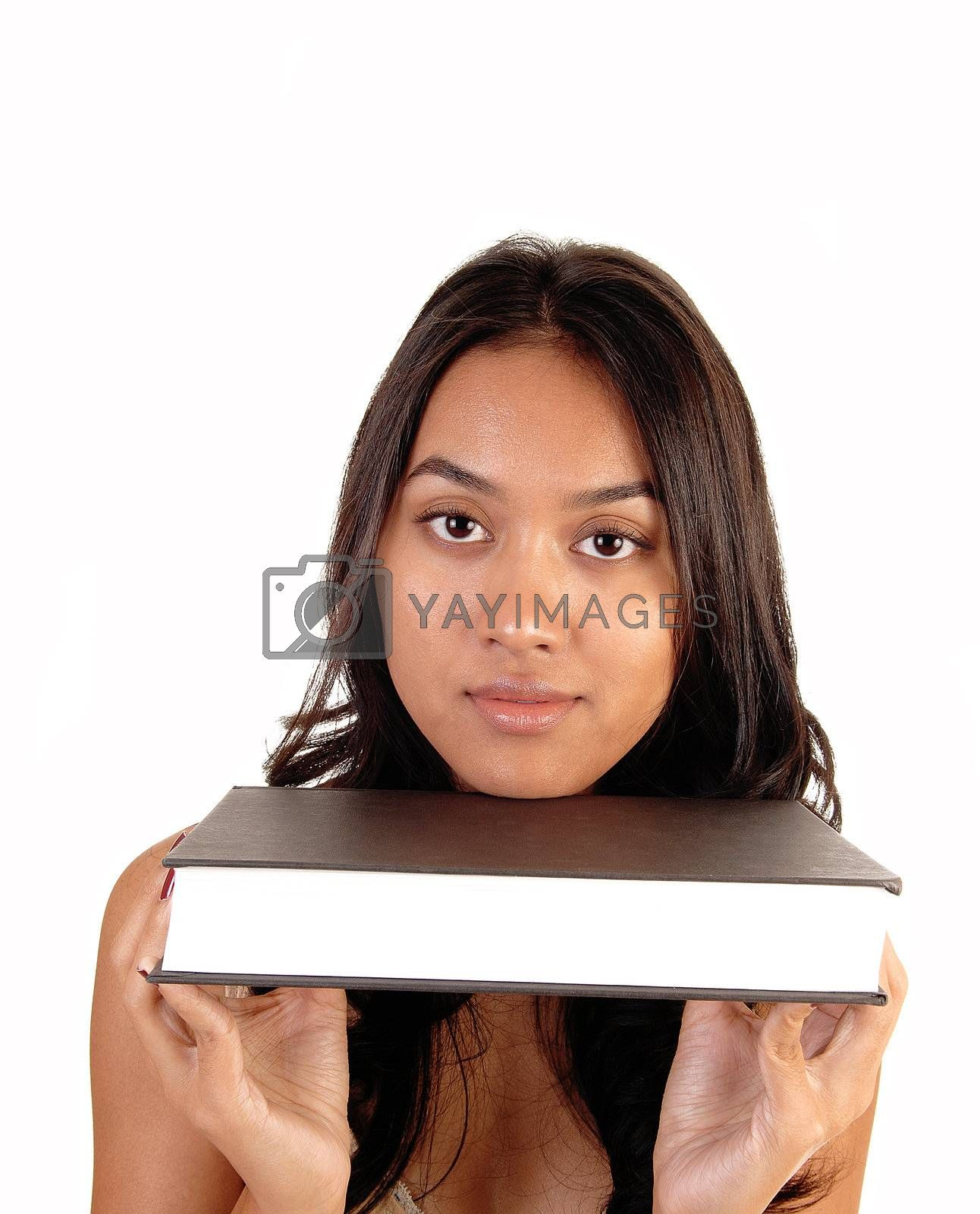 A lovely Asian girl holding a brown coffered book under her chin, for white background.