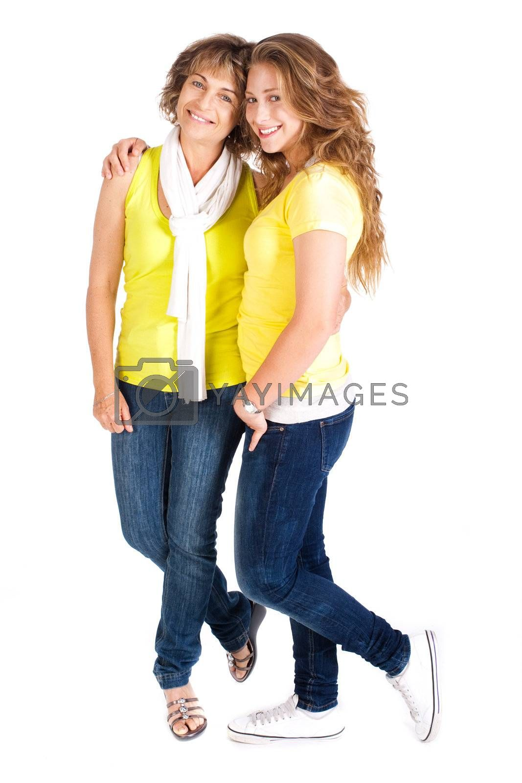 Young pretty daughter embracing her mum, indoors isolated on white background.