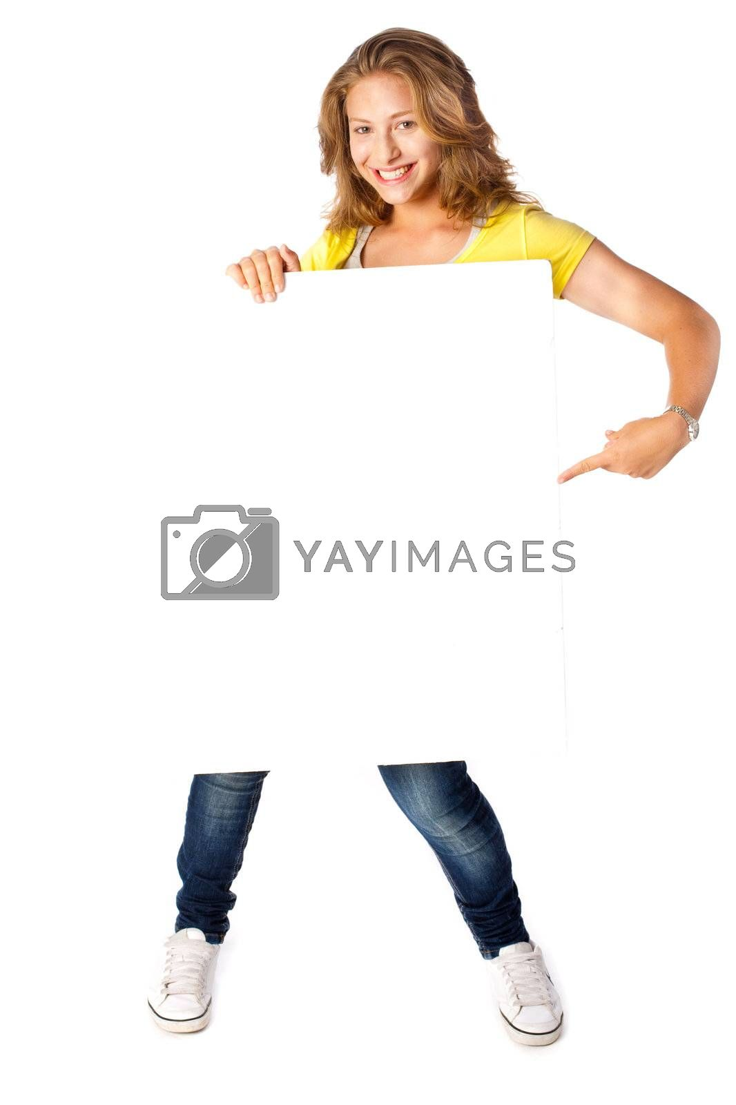 Happy young woman holding a blank billboard on white background