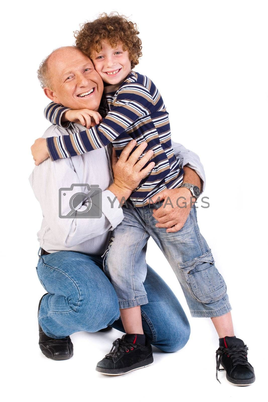Grandson hugging his grandpa, isolated over the white background.