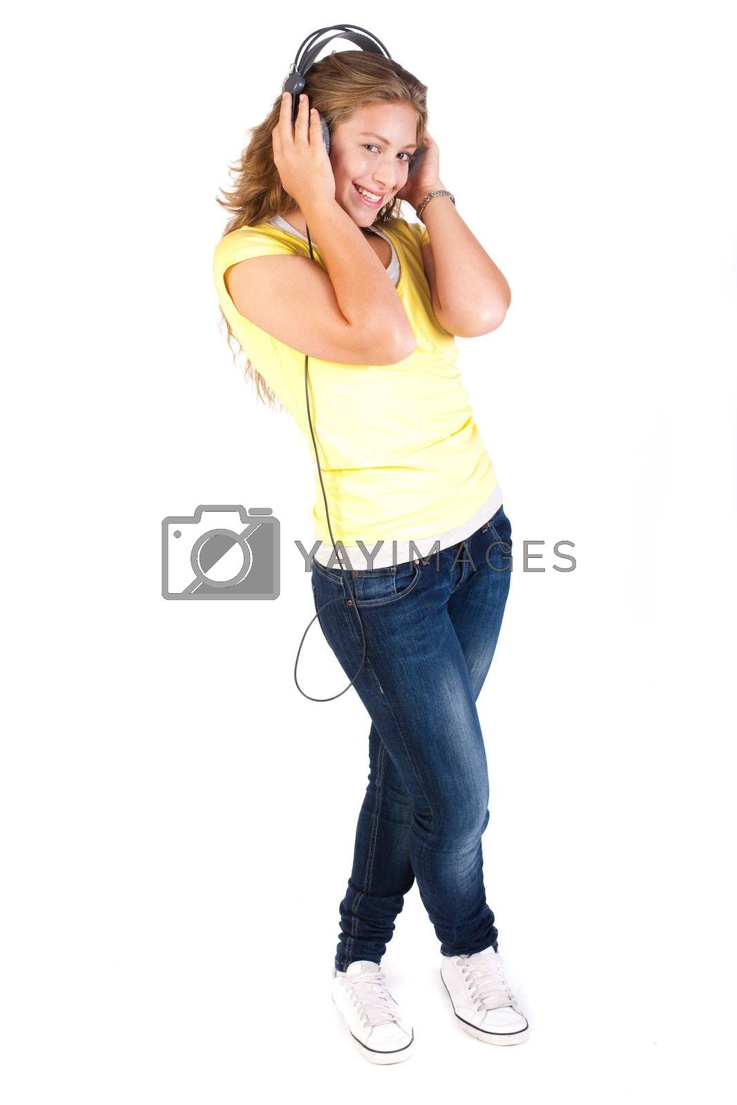 Cheerful caucasian woman listening and enjoying music, facing camera isolated on white background.