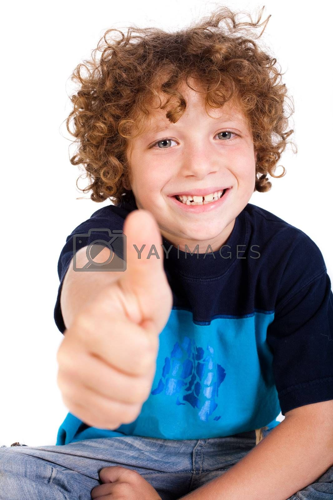 Casual young kid showing thumbs up and smiling at camera.