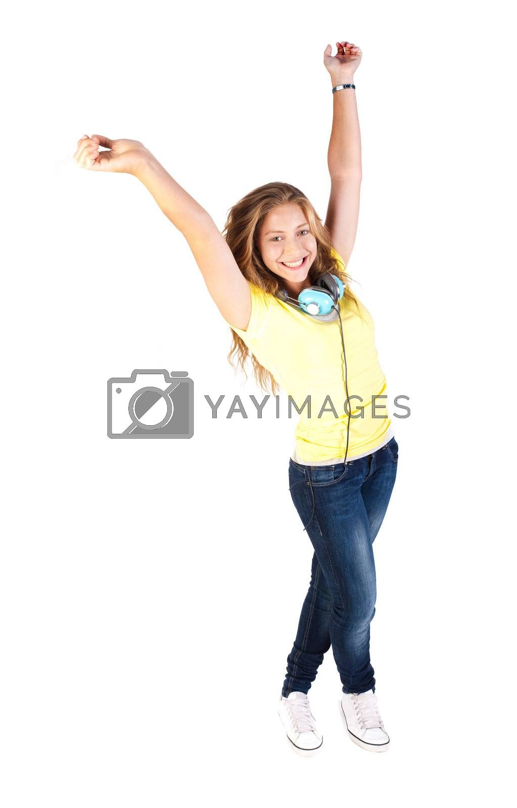 Young girl enjoying music through headphones, smiling at camera, isolated on white bacground.