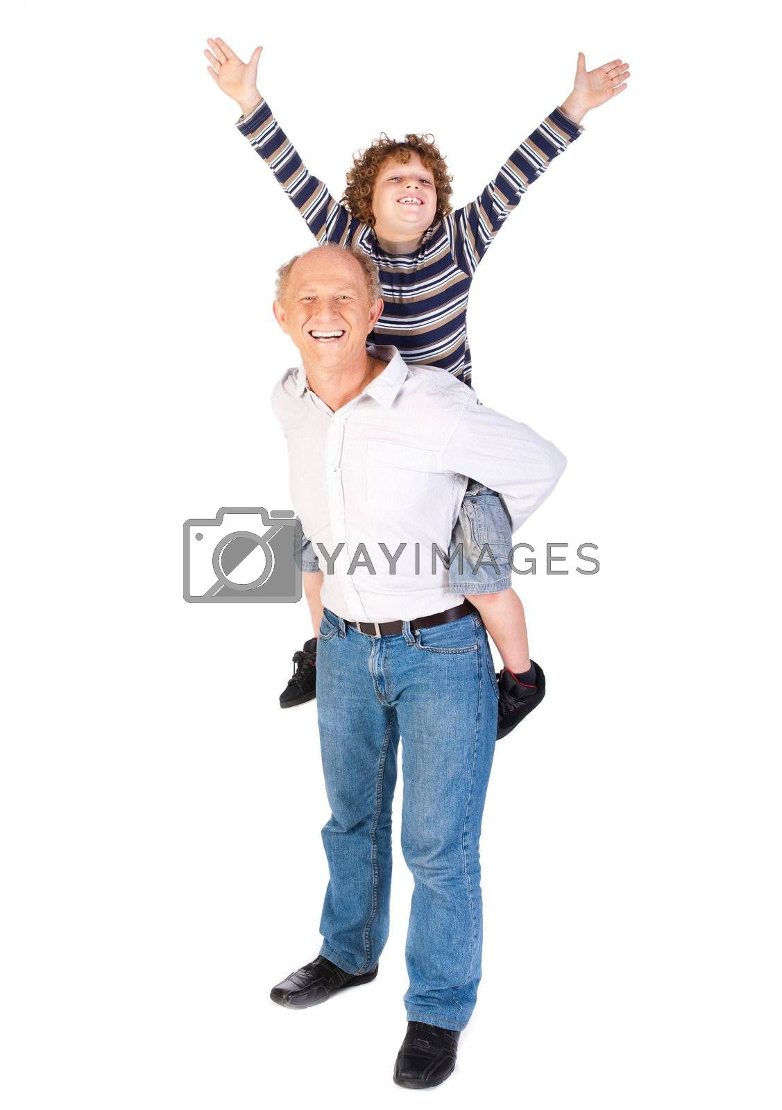 Grandfather giving grandson piggy-back by get4net