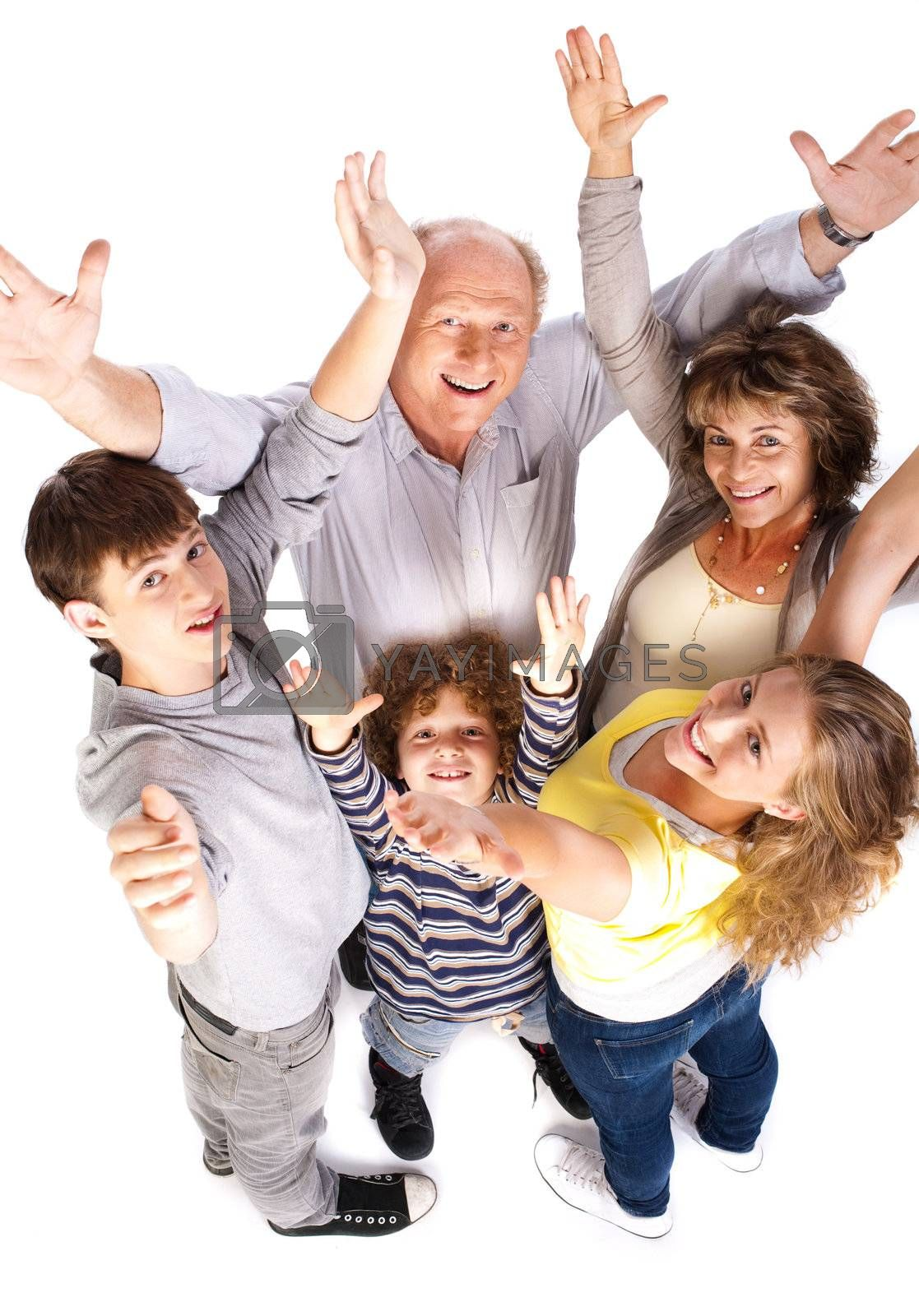Aerial view of cheerful family with raised arms and looking at camera..