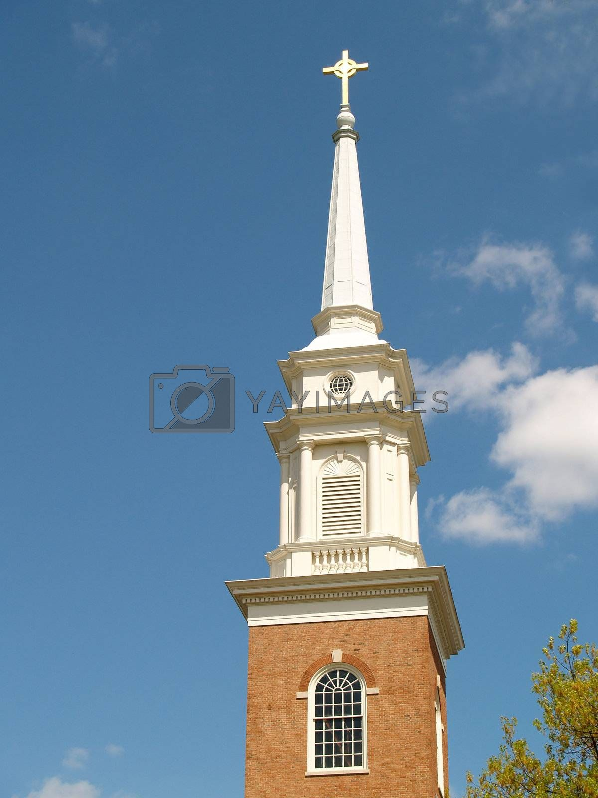 a white steeple on top of a red brick church