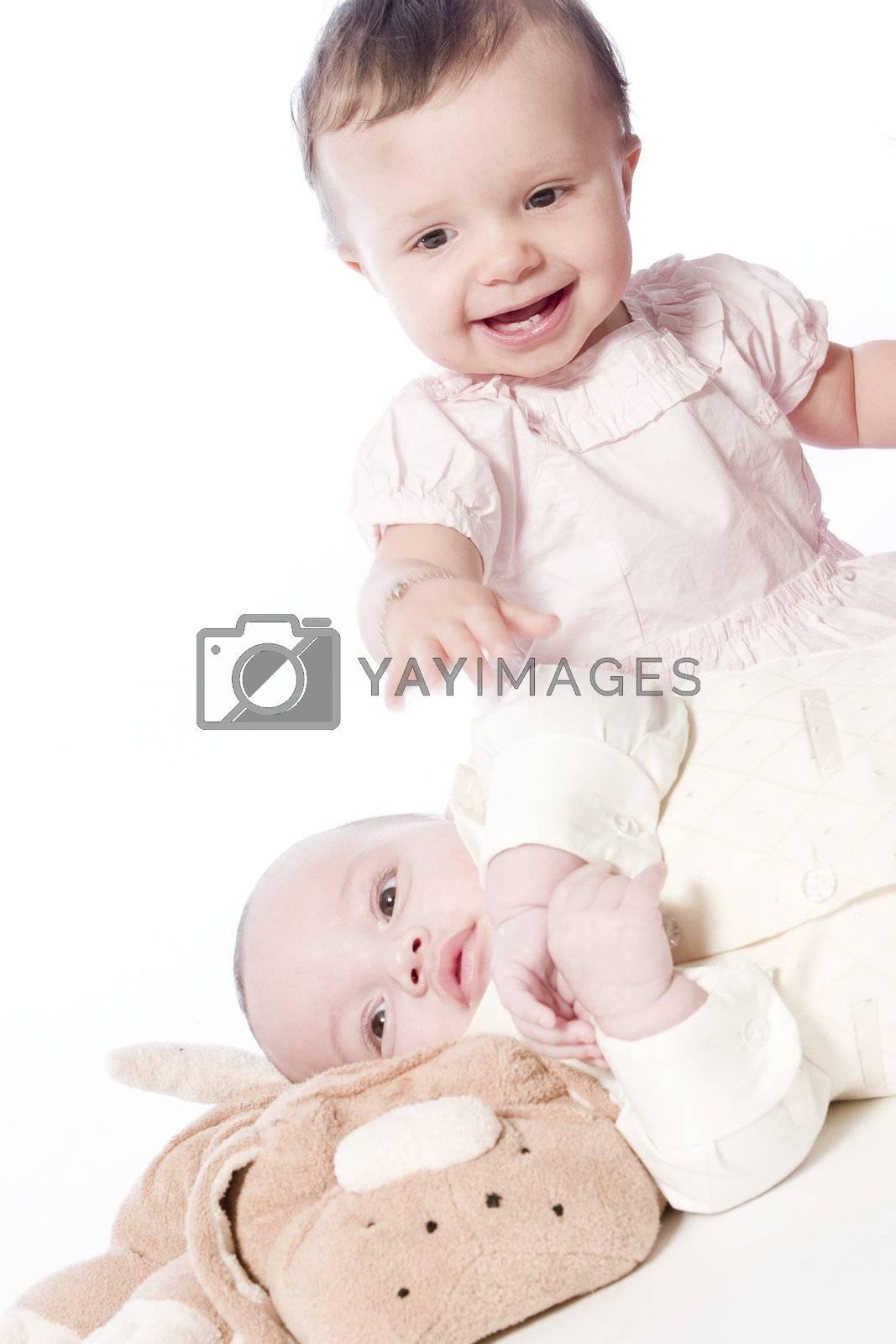 little children portraits taken in the studio on a white background
