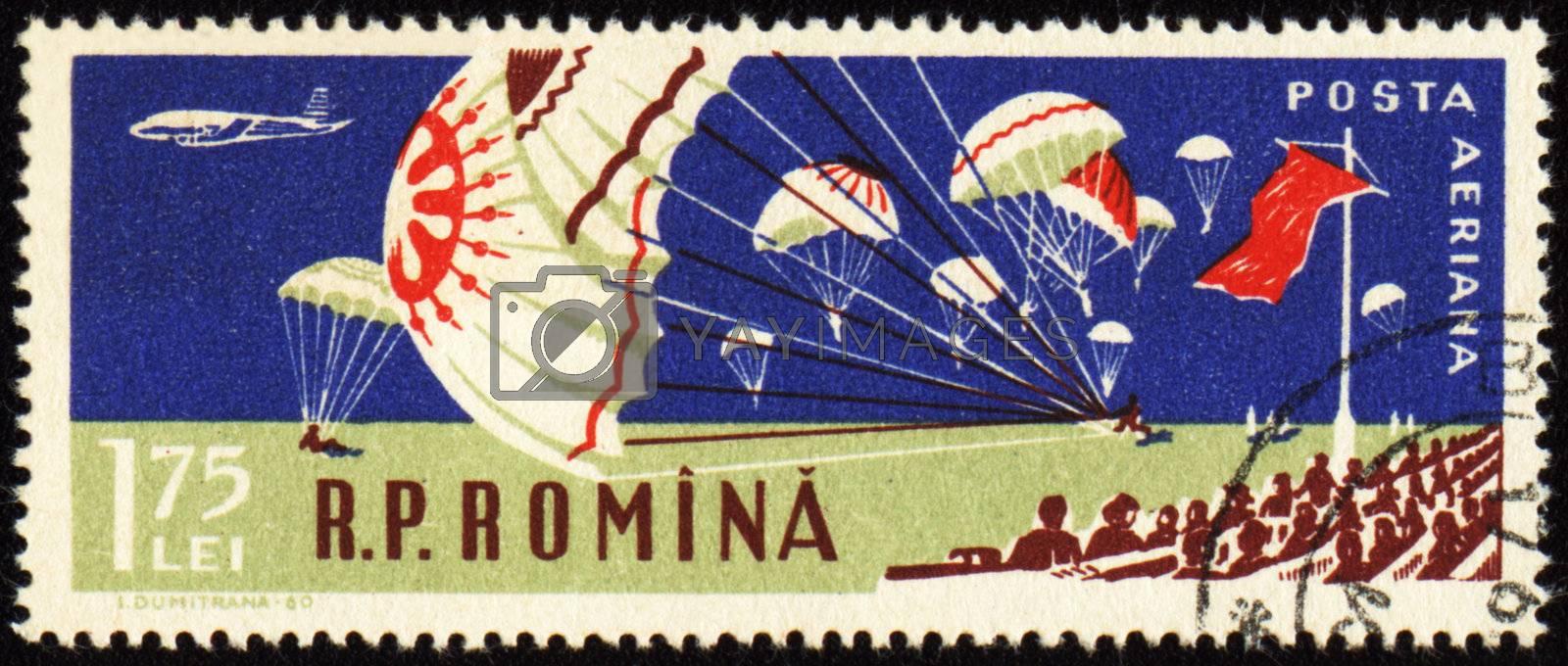 ROMANIA - CIRCA 1960: Parachutes at aviation sports event, landing in stadium, circa 1960