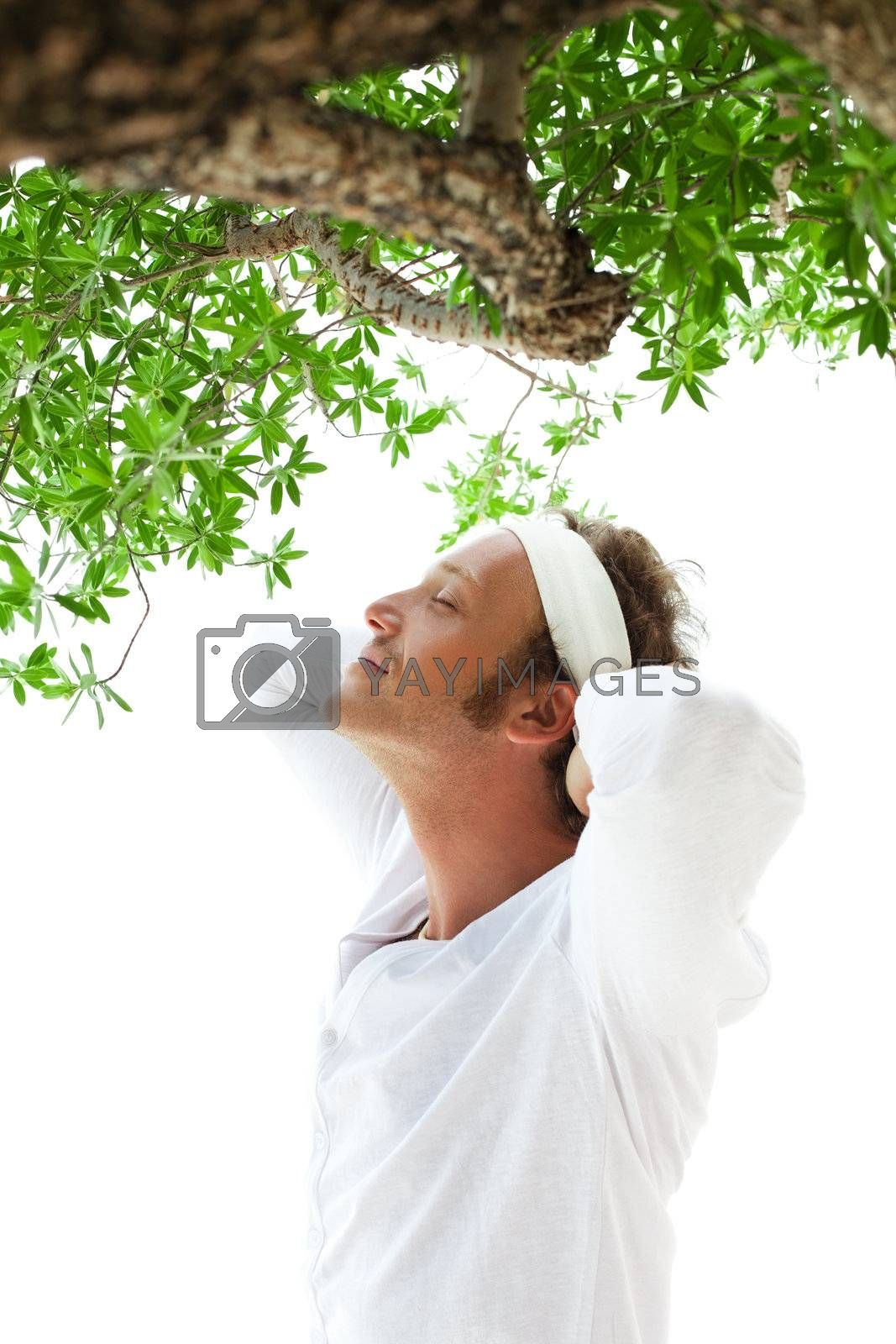 serene men doing yoga and relaxing under the tree
