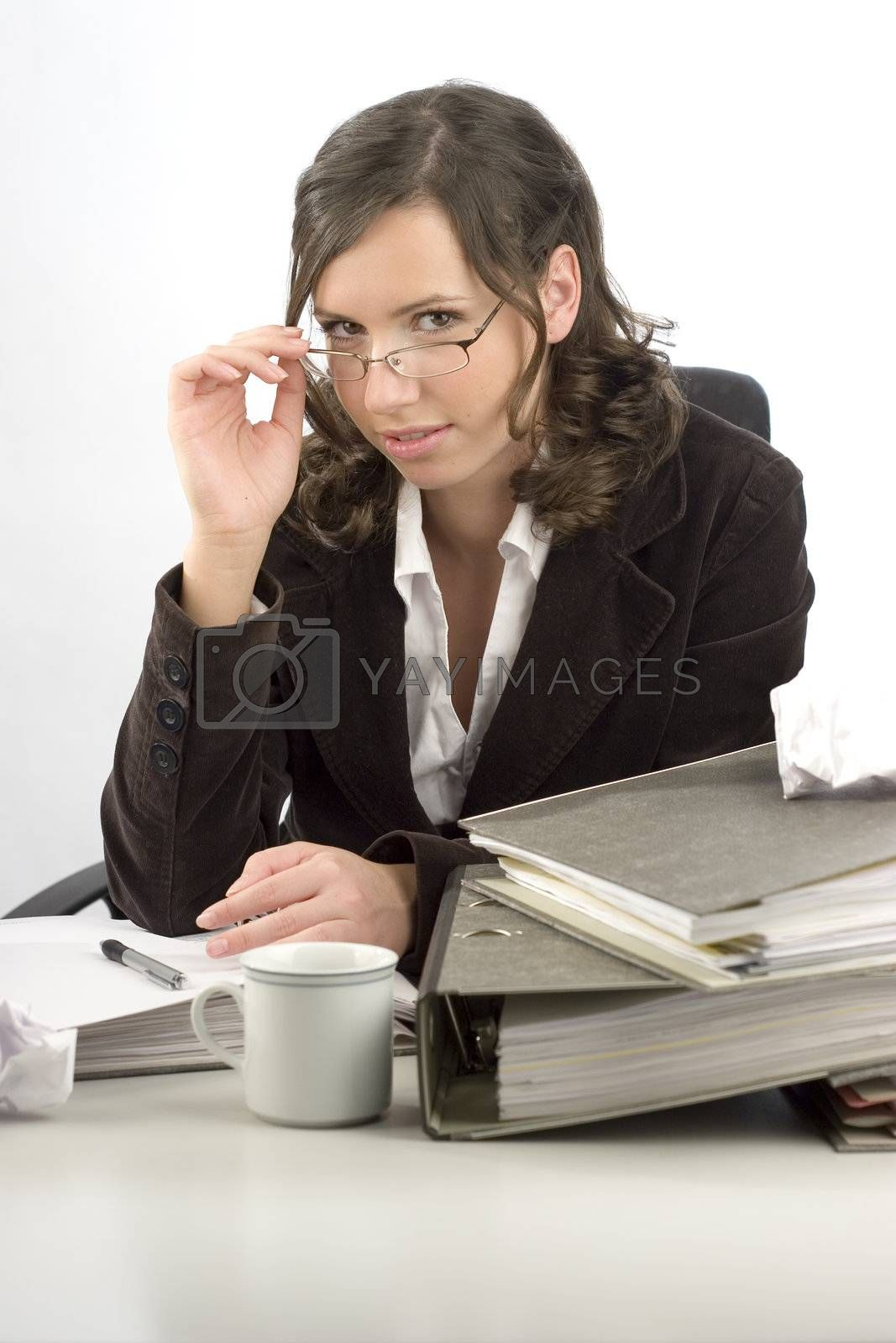 Young businesswoman sitting at desktop with folders