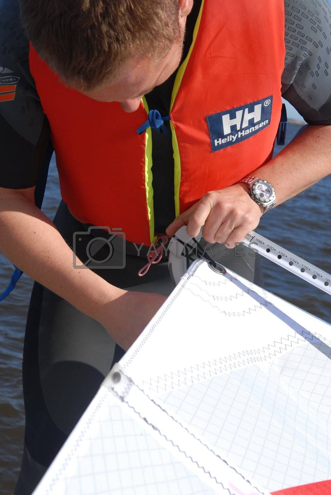 a man wears life jacket. Please note: No negative use allowed.
