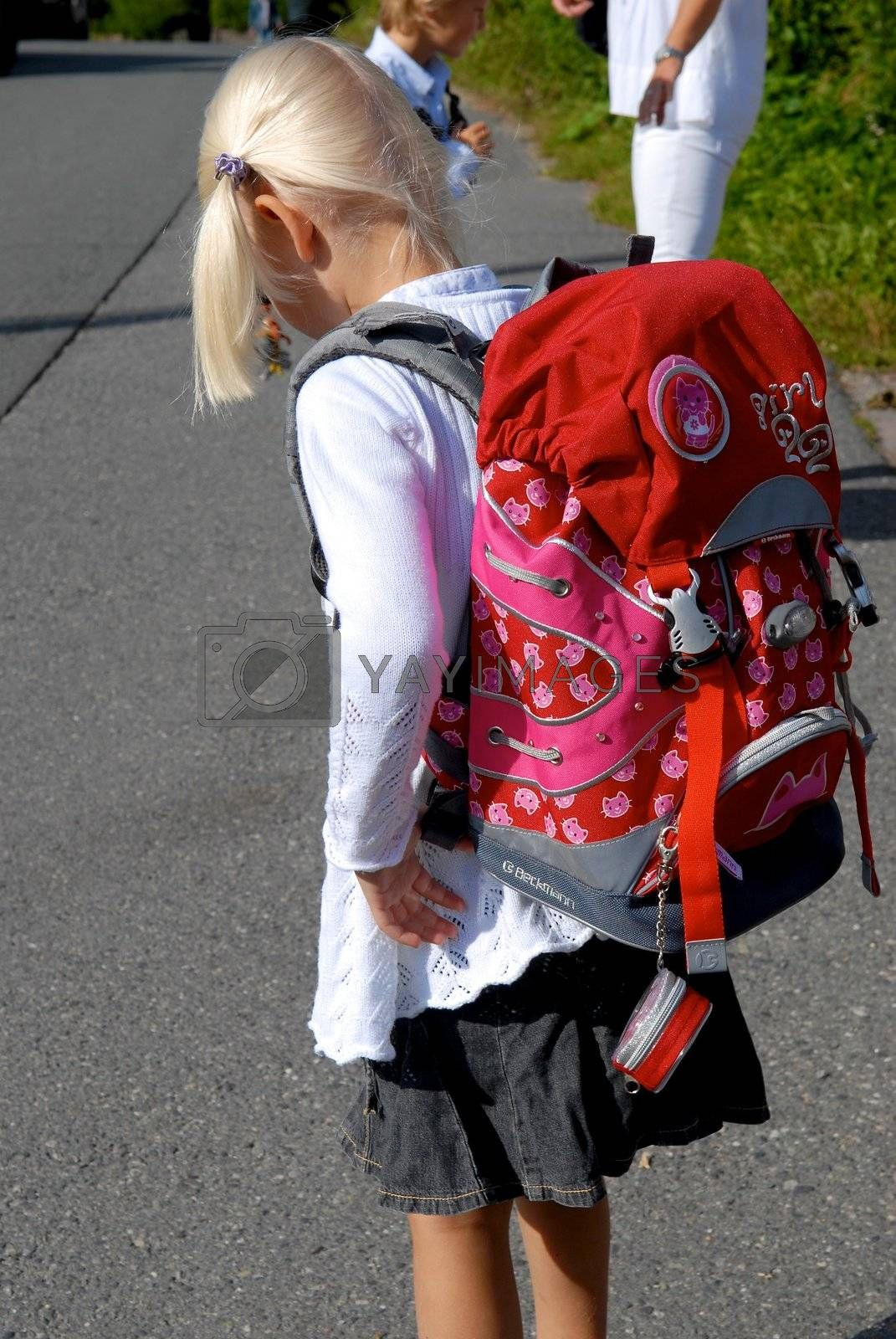 a girl with red schoolbag. Please note: No negative use allowed.