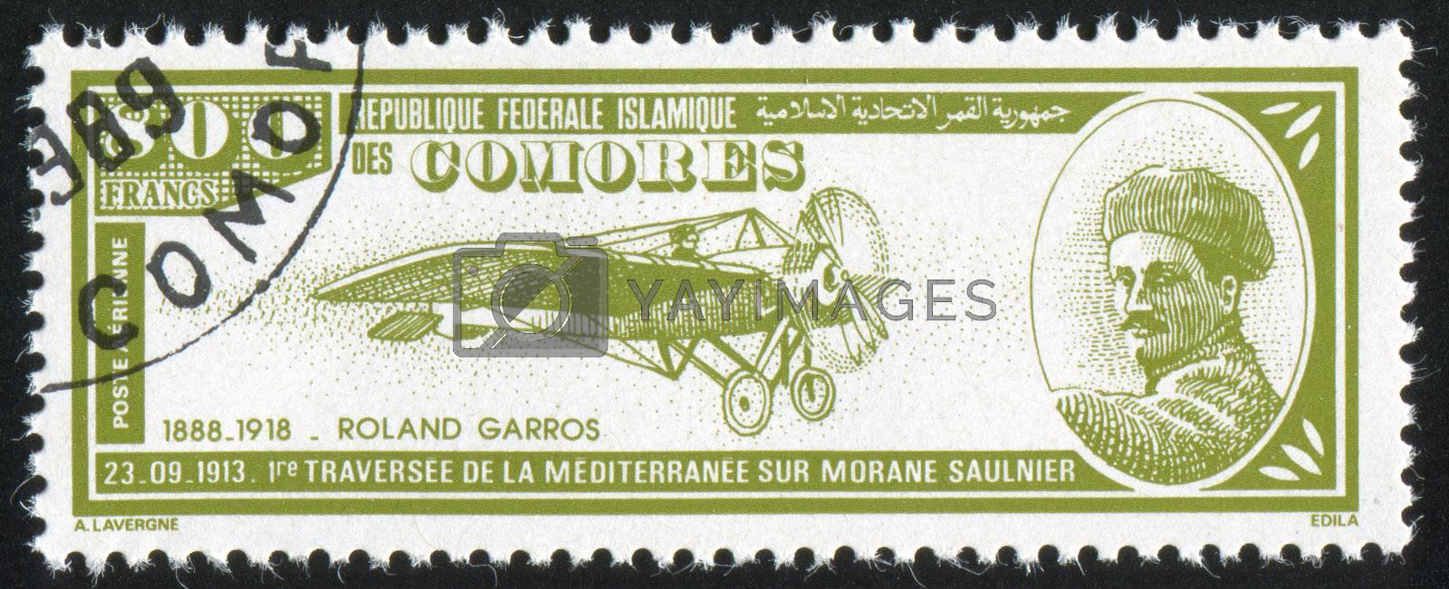 COMORO ISLANDS - CIRCA 1988: stamp printed by Comoro islands, shows airplane and Roland Garros, circa 1988