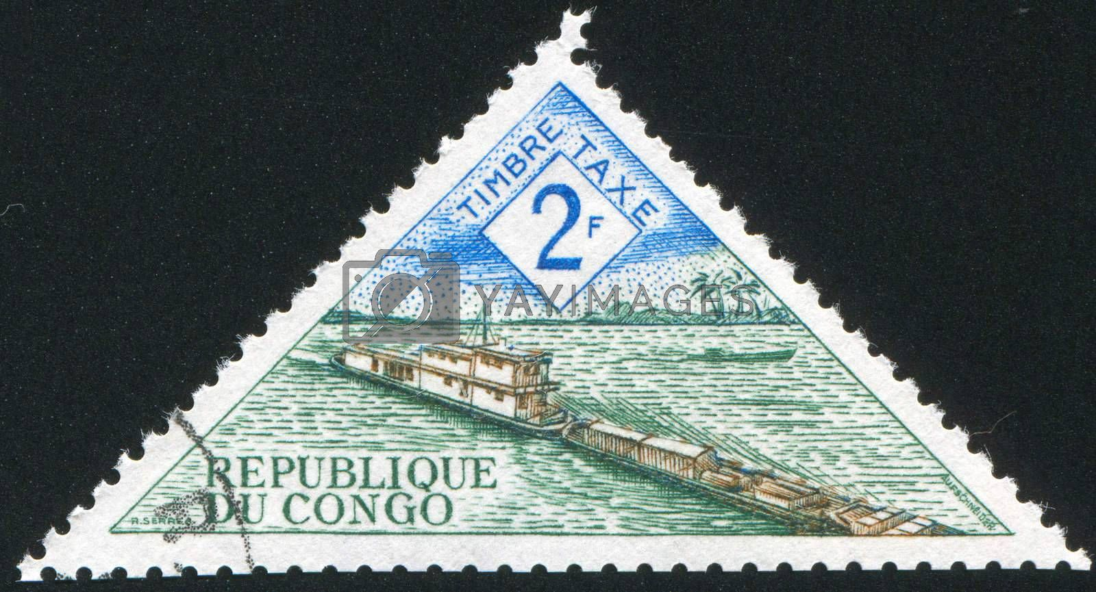 CONGO CIRCA 1961: stamp printed by Congo, shows River boat transporting barge, circa 1961