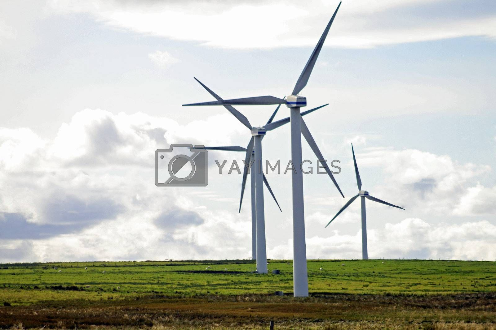 Typical windmill in a field creating aeolian energy