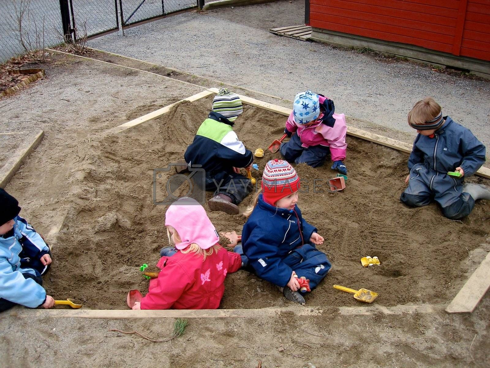 children playing with the sand. Please note: No negative use allowed.