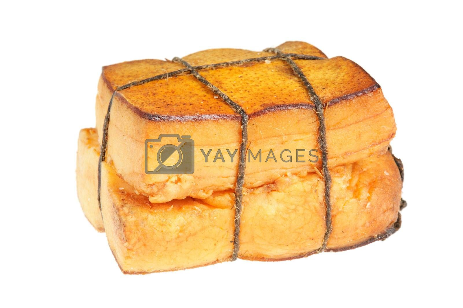 A piece of smoked bacon, tied with string. Isolated on white.