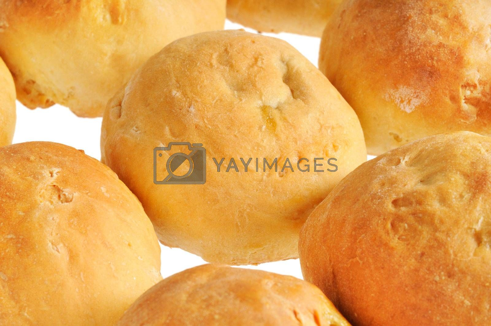 Buns, standing in a row. Isolated on white background.