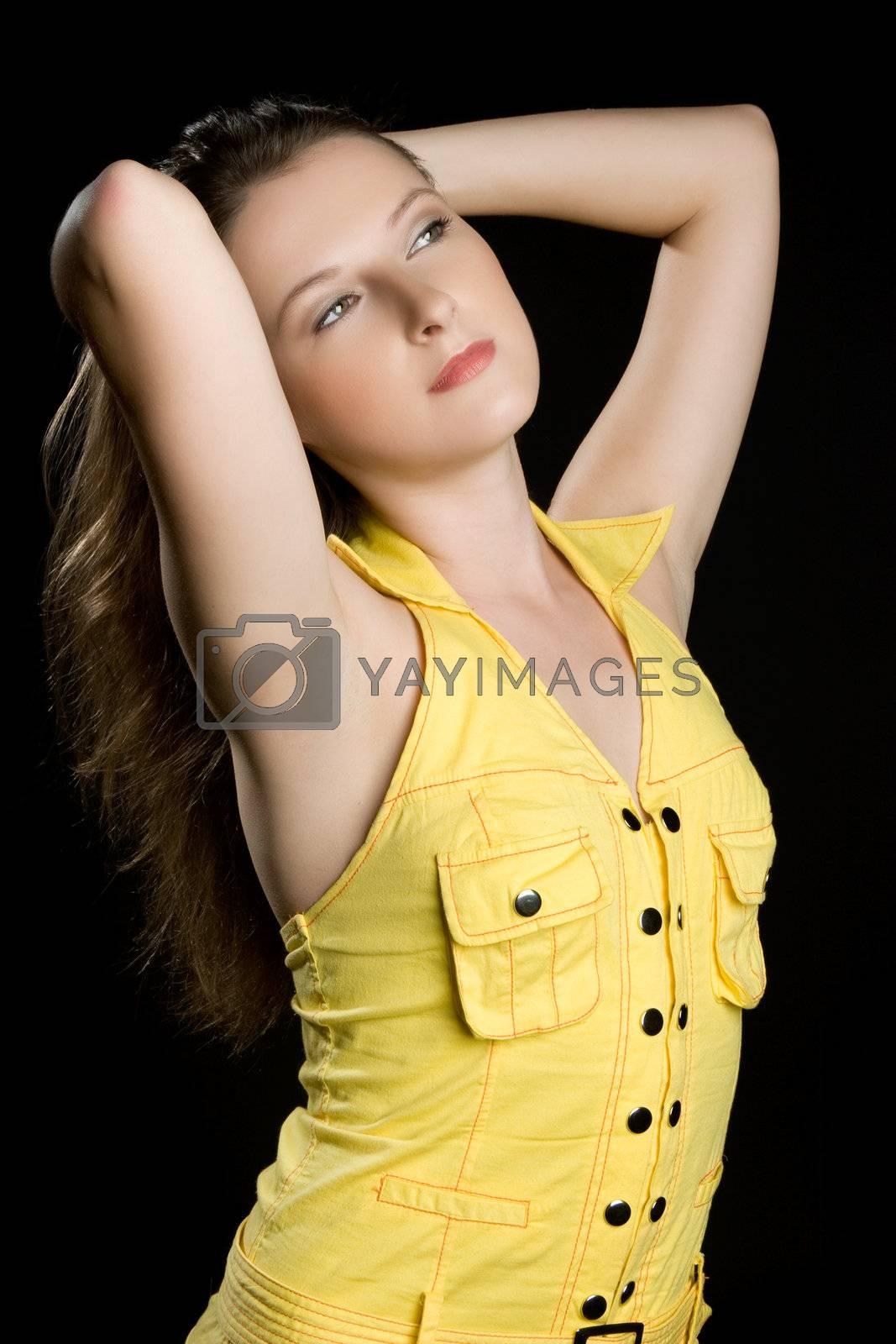 Pretty brunette woman black background