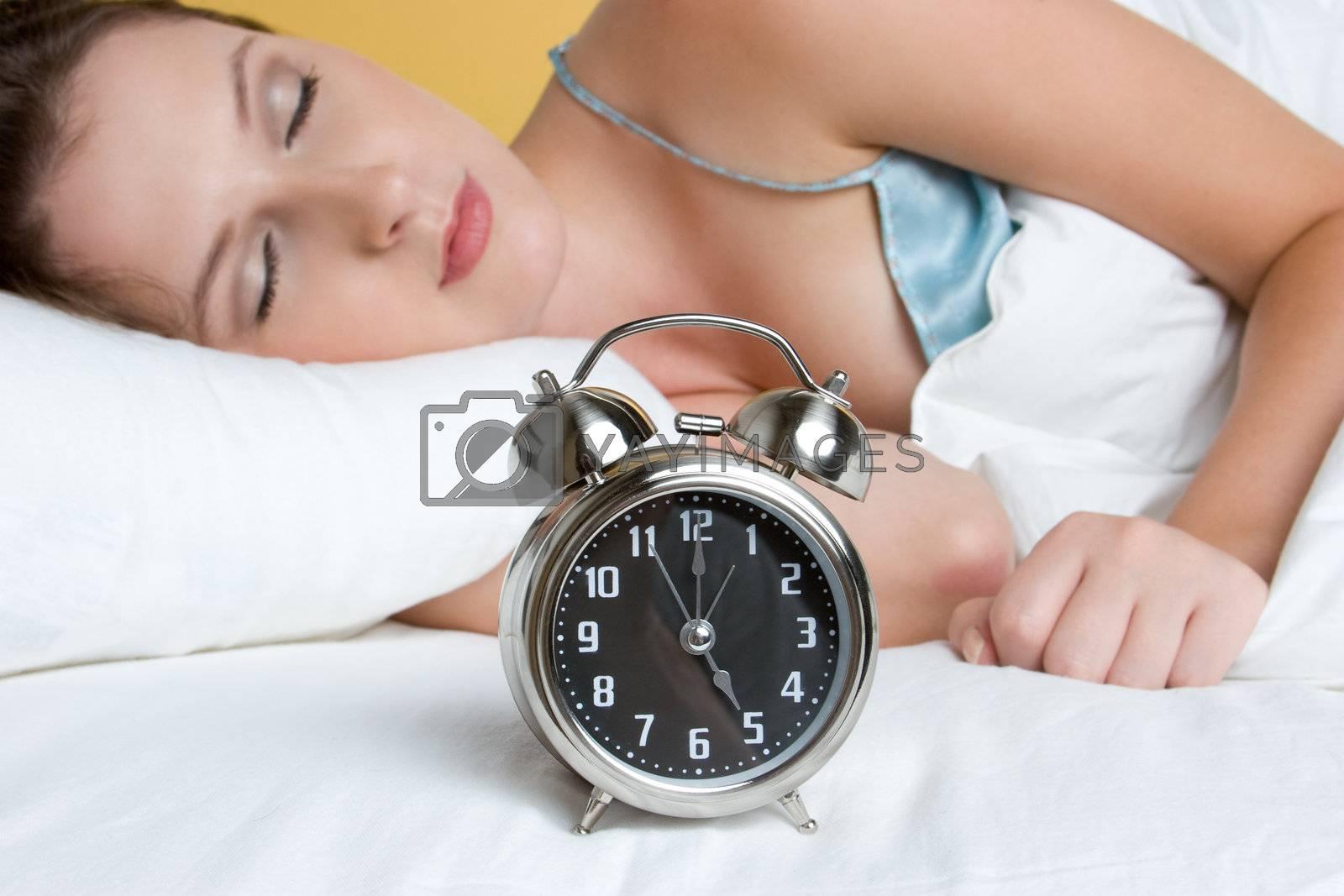 Woman sleeping alarm clock bed