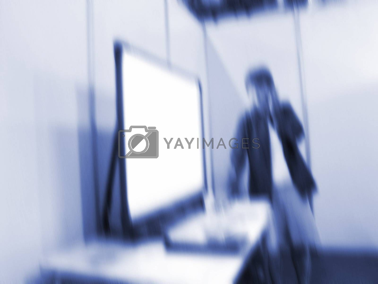 Female teacher in front of screen - motion blur.