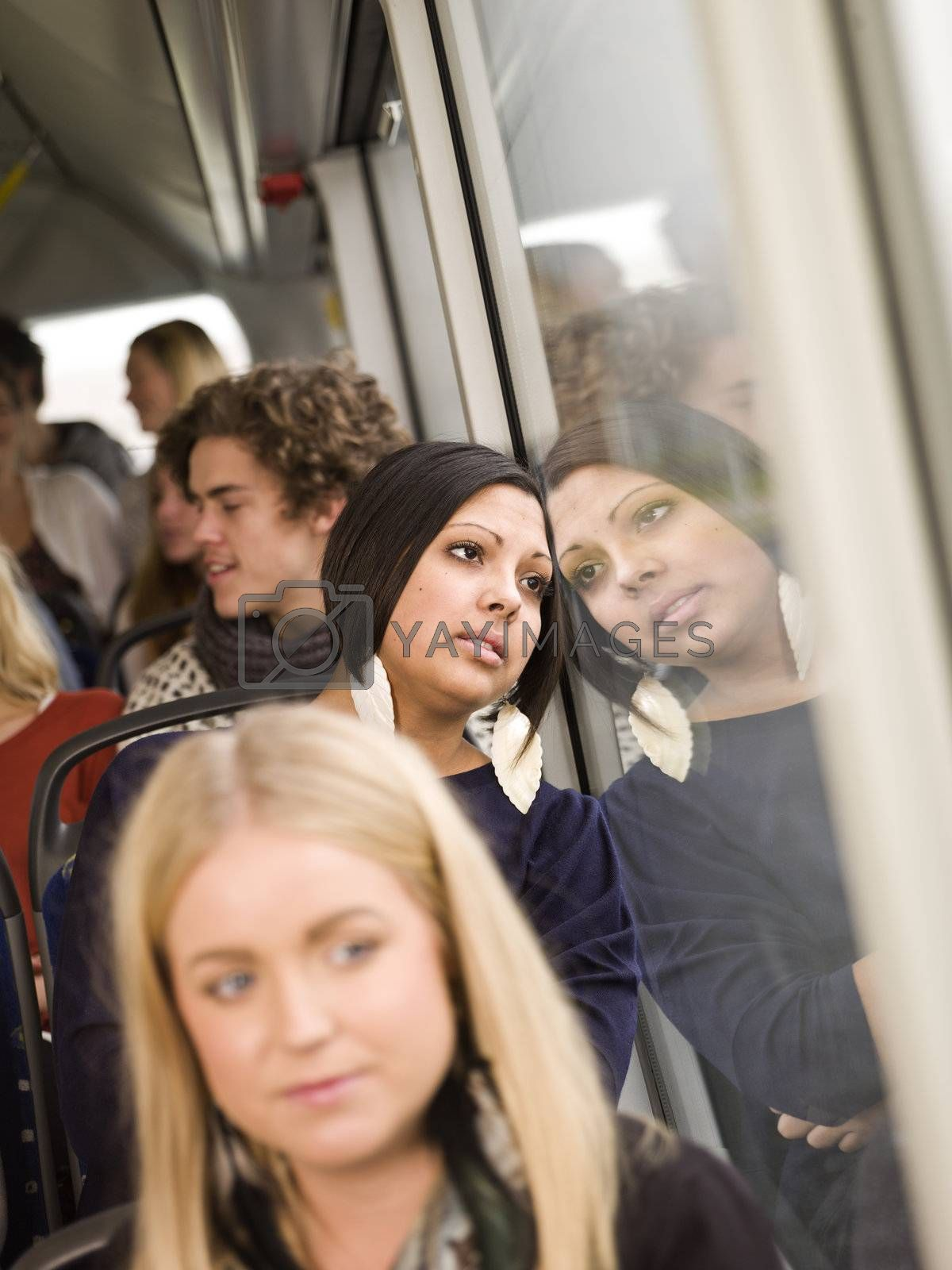 Serious woman on the bus with large group of people
