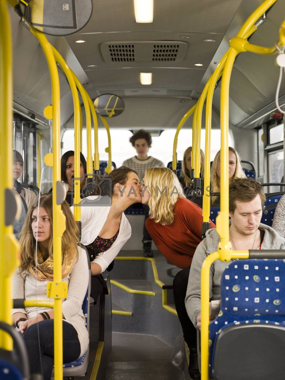 Kissing women on the bus