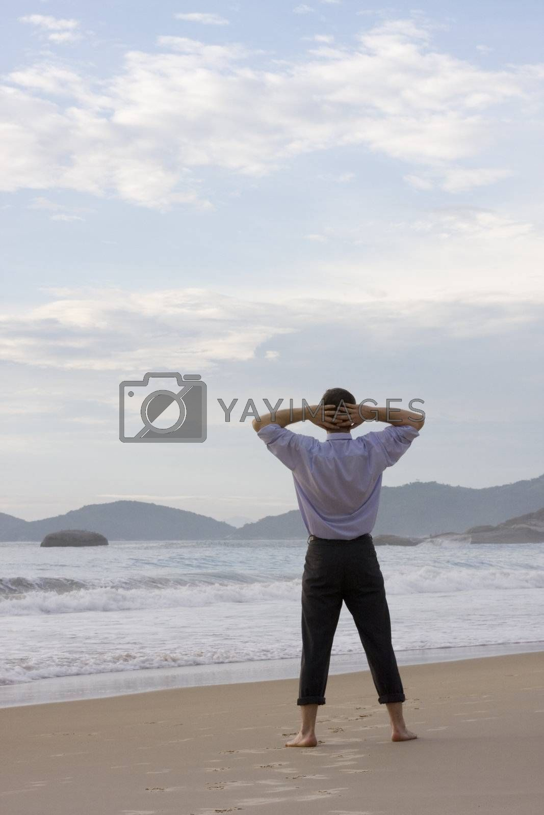 Businessman relaxing barefoot on the beach