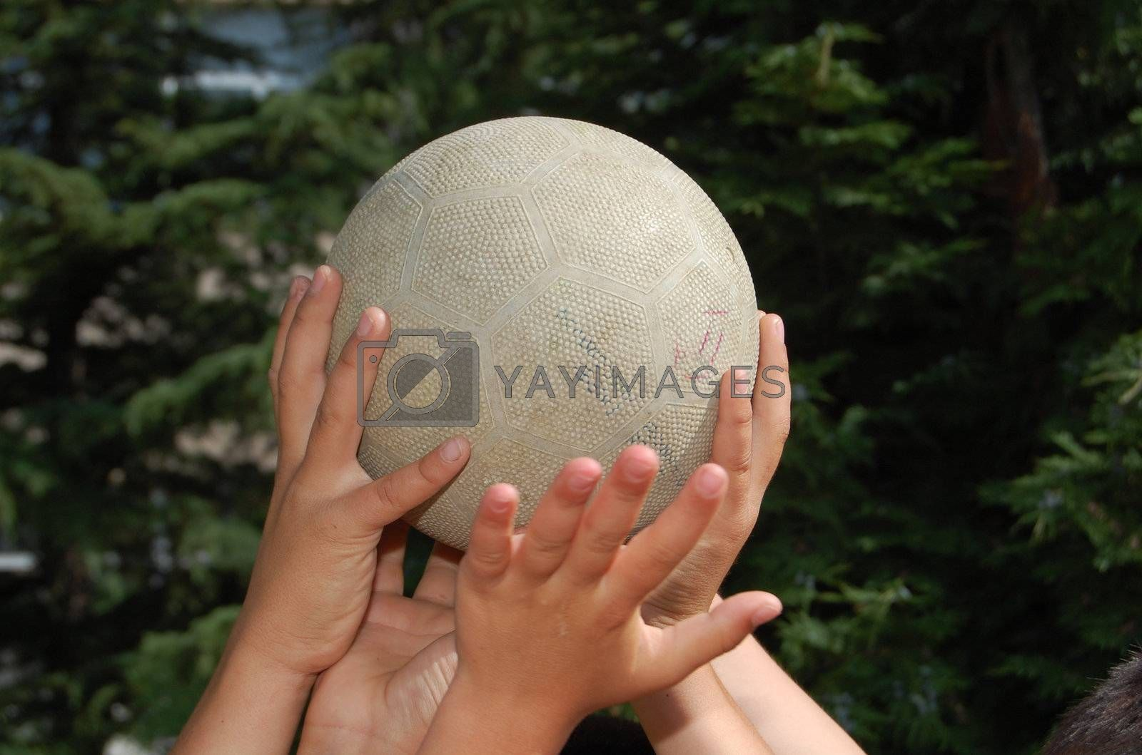 hands of boys holding ball