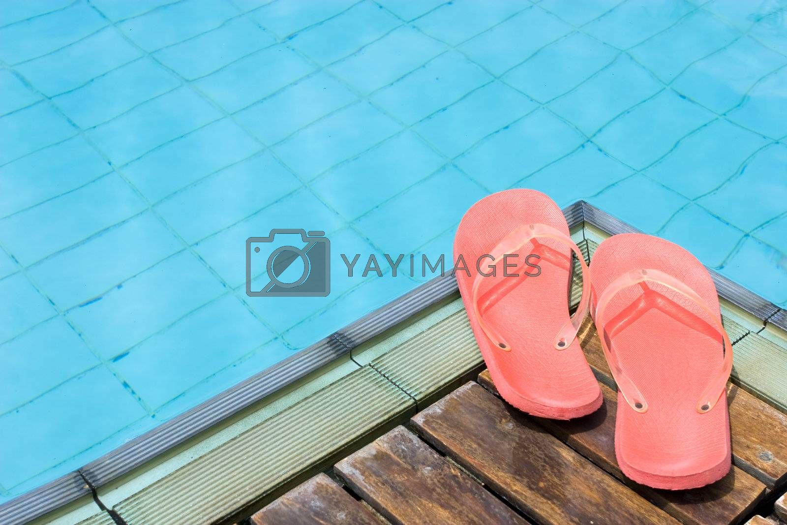 Red Flip Flops by the pool.