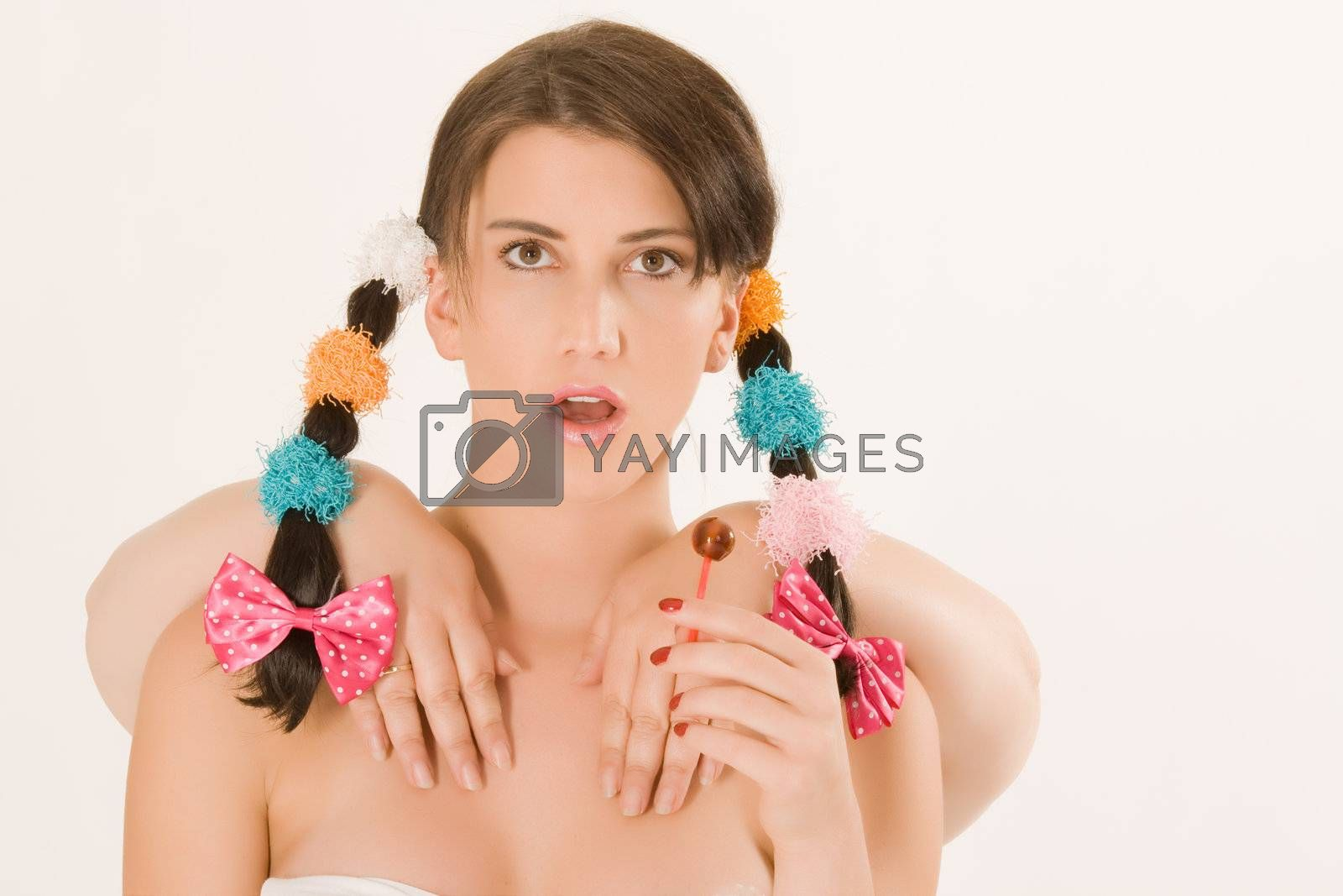 Young woman with two braids and colorful four hands