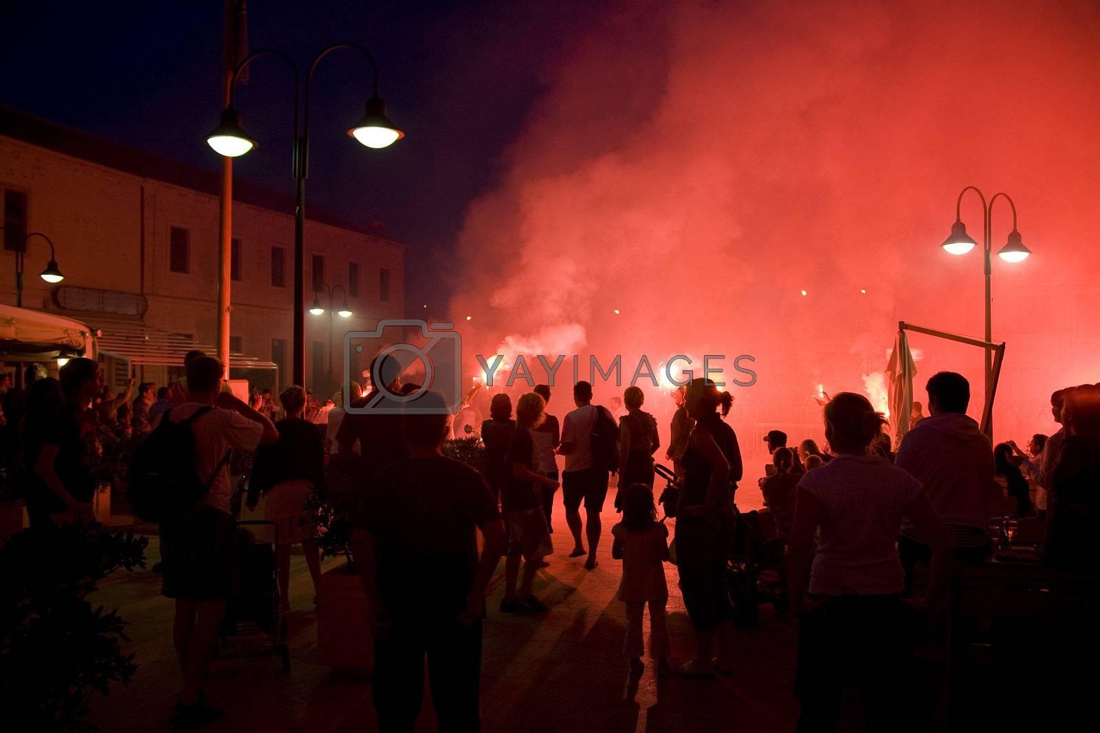 Red firework celebration after a Croatian wedding.
