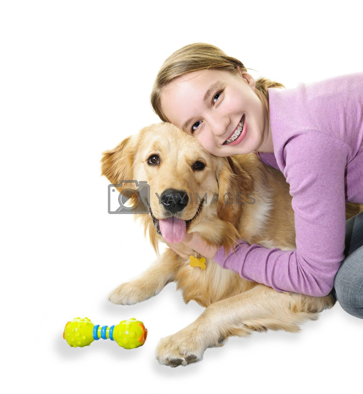 Teenage girl hugging golden retriever pet dog isolated on white background