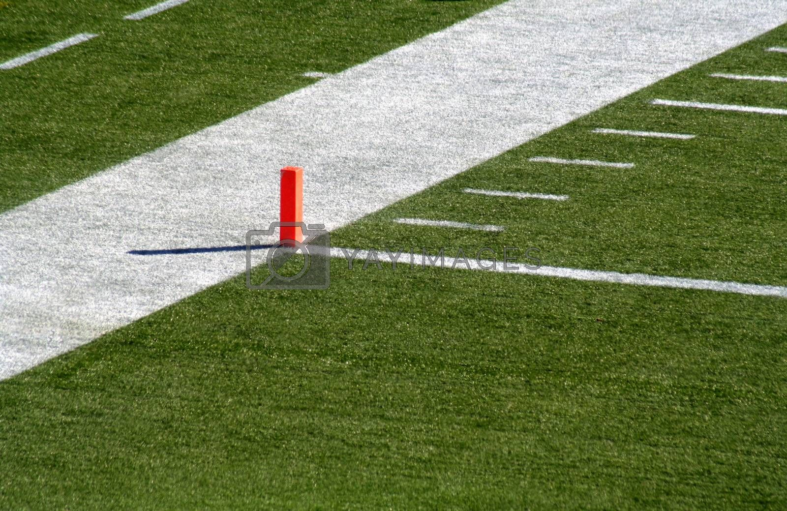 A shot of the endzone showing the goal line and the orange marker.