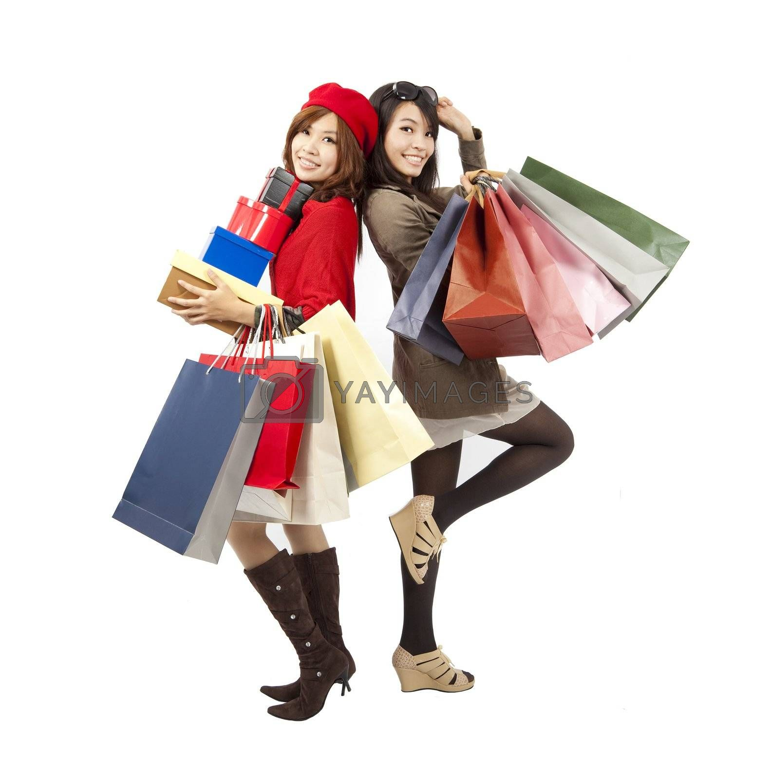 happy asian fashion girls holding shopping bag and gift box