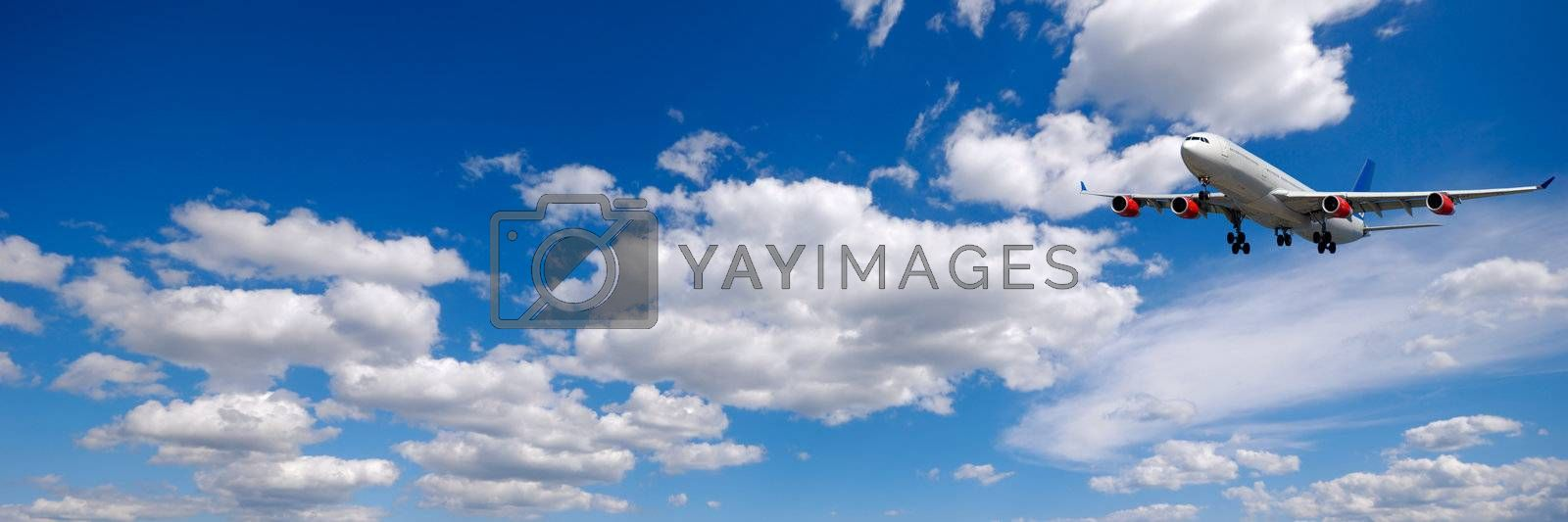 Plane and cloudscape and blue sky