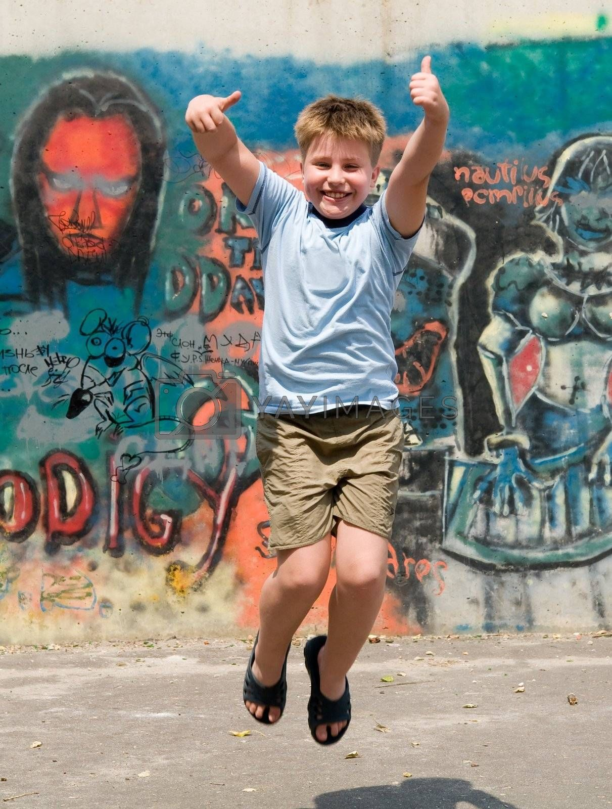 The jumping child with graffiti at background
