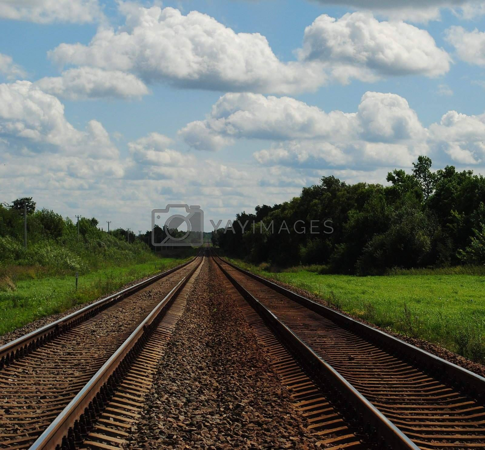 a colourful landscape with a railway to somewhere,