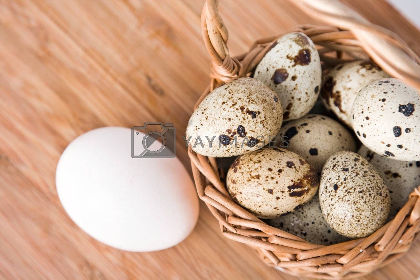 eggs in basket on a wood background, small focus